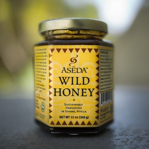 Aseda Large Raw Wild Honey Jar is filled with honey from Africa made by happy bees and harvested sustainably from the Molé National Forest in Ghana.