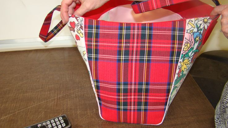Side view of bag. I used the red tartan skirt as the side pieces and incorporated pink piping to tie it all together.