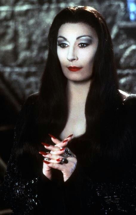 Anjelica Huston. Here as Morticia Addams on The Addams Family. Costume designed by Ruth Myers.