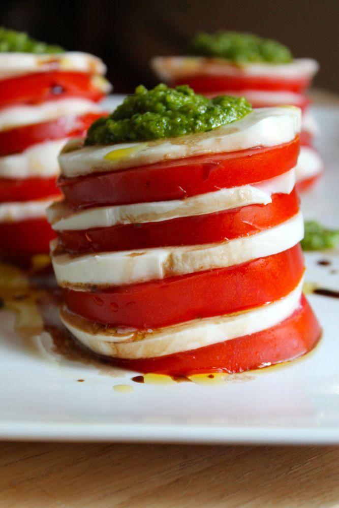 Ever try garlic scapes? They make a delicious pesto! Tomato and mozzarella salad with garlic scape pesto recipe | The Foodie Dietitian