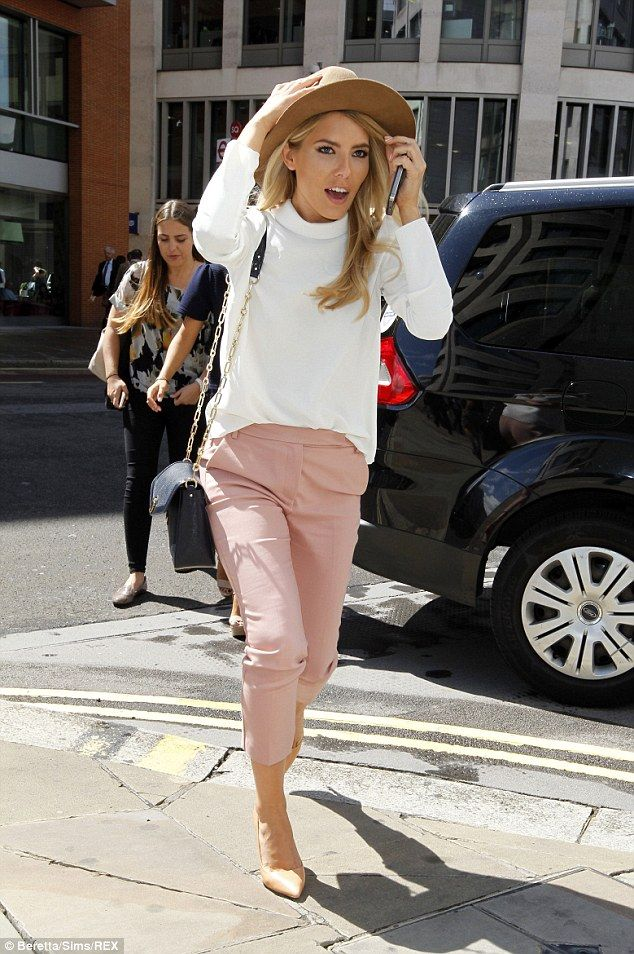 Trend-setter: Mollie coordinated in pastel colours as she combatted the wind in a camel-co...