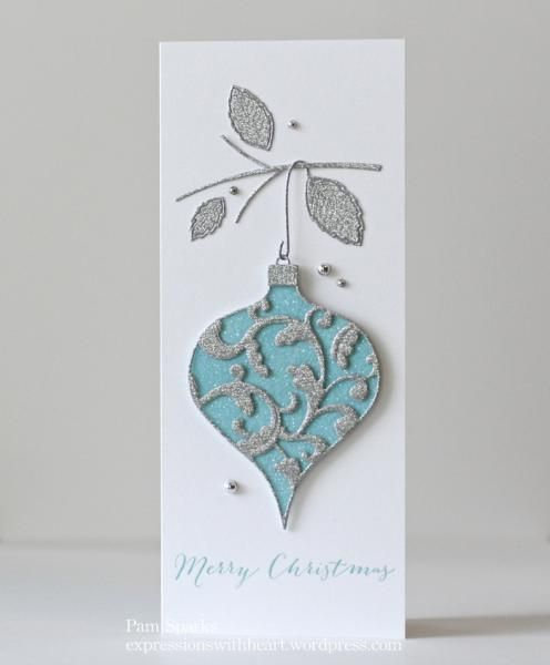 I'm in love with this tall card! The silver glitter card-stock, this beautiful Ornament die glittered and Sturdy Stem die…so pleased with this when it was done! TFL! Details on this blog post… [url=http://expressionswithheart.wordpress.com/2014/07/11/memory-box-elliana-dies/][color=brown]Expressions With Heart - Elliana Ornament[/color][/url]