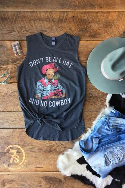 "The Cowboy - ""Don't be all hat and no cowboy"" graphic tank. Vintage hue colorful graphics on tri-blend graphite. Nice loose fitting comfortable tank. Slightly rounded hem. Arm holes fit nice without showing bra."