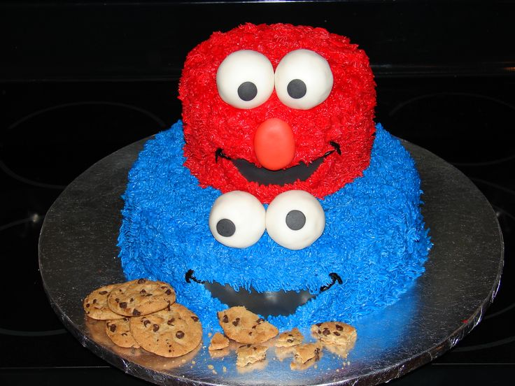 Elmo and Cookie Monster Cake - Elmo and Cookie monster cake I made for a little boy turning 2 in a local shelter