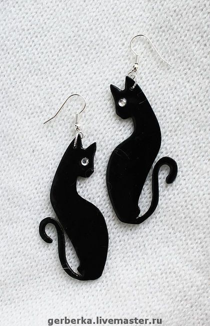 black cat earring or pendant.  would be cute with a green crystal eye.