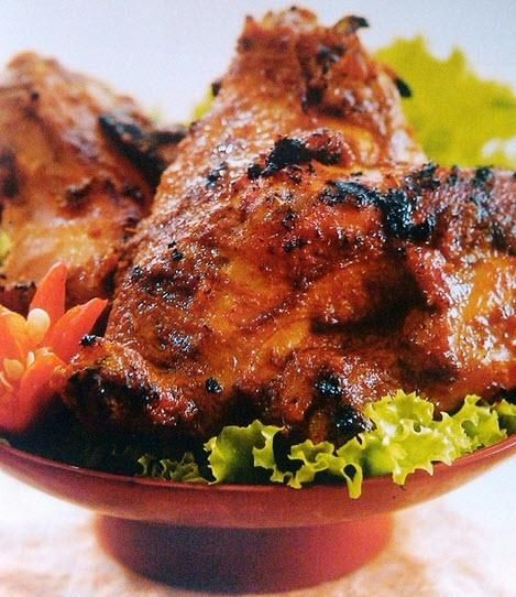 Ayam Goreng Kalasan - local organic free-range chicken, stewed in spices (coriander, garlic candlenut and coconut water) then fried, served with sambal and raw vegetables salad. http://foodmenuideas.blogspot.com/2013/10/indonesian-food-getting-to-know.html