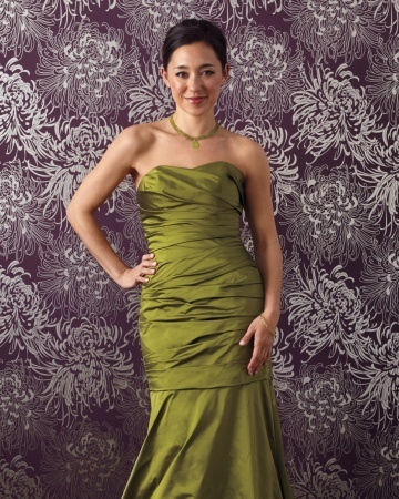 """Glamorous Bridesmaids Dress  With a ruched bodice and dropped flare point, this floor-length taffeta mermaid gown compliments every figure. To make an even bigger statement, wear it with a necklace in the same shade.  Watters Maids gown #9614 (watters.com). Gabrielle Sanchez necklace in prehnite (ABC Home, 212-473-3000). Paolo Costagli """"Very PC"""" bangle (paolocostagli.com)."""