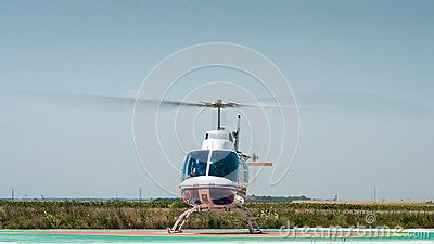Helicopter take off. Copy space at top on clear blue sky.