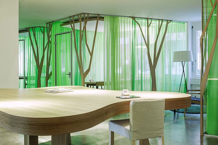 My Money Park office by OOS, Zurich – Switzerland. Lovely green office design. See how the green curtain merge with the trees. You can almost hear the wind  blowing.
