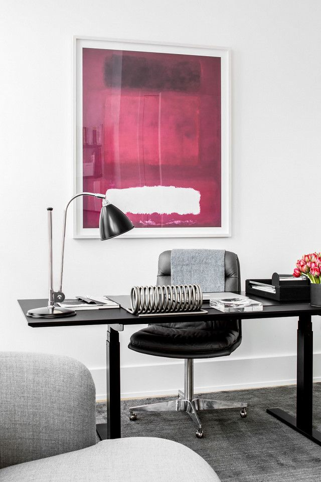 Home Office Space That Doubles As A Guest Room With Simple Black Desk And