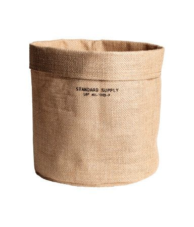 Natural. Small jute storage basket with laminated inside. Diameter 8 3/4 in., height 8 3/4 in.