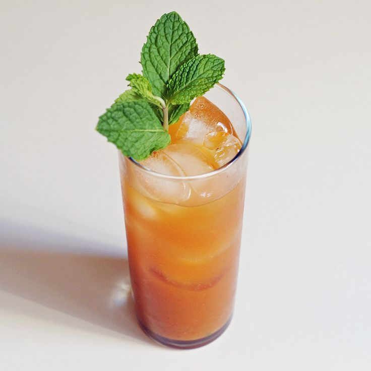 Pumpkin Mojito 11 mint leaves, plus a sprig for garnish  1 tablespoon brown sugar  1 1/4 ounces aged rum  1 tablespoon pumpkin puree  Juice of 1/2 a lime  2 ounces club soda