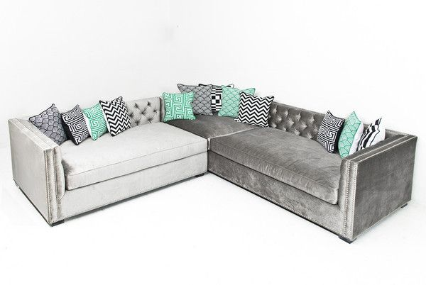 """The enormous sectional in chic Brussels Charcoal velvet features hand button tufting in the seat back, Down filled cushions, individual chrome nailheads, and 2"""" lucite block legs legs. This adds the p"""
