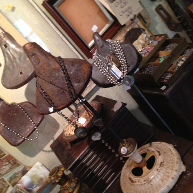 Bicycle seat necklace displays