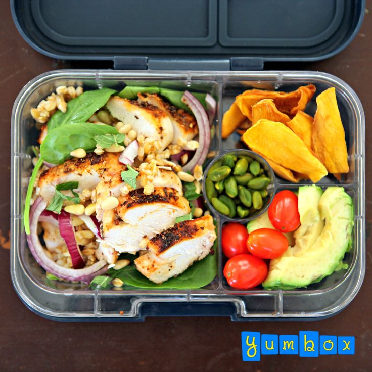Healthy eating simplified. #Yumbox packed with barley, grilled chicken, spinach, red onion and pine nuts salad. Accompanied by dried mango, baby tomatoes and avocado. Pistachios for a treat. Lunch packed in Espace Blue Yumbox Panino.