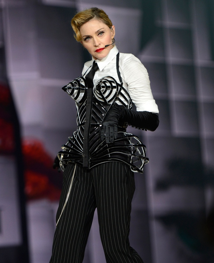 Madonna wearing the 3D cage corset especially created for her 2012 MDNA Tour by Jean Paul Gaultier. #MDNA #VOGUE #Madonna