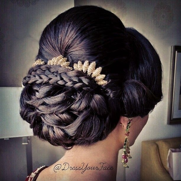 Here's a recent bridal updo featuring a low sculptured bun and braids placed under the dome to prop-up the accessories. Hair style by me @Crystal Lopez #DressYourFace  - @Crystal Lopez- #webstagram