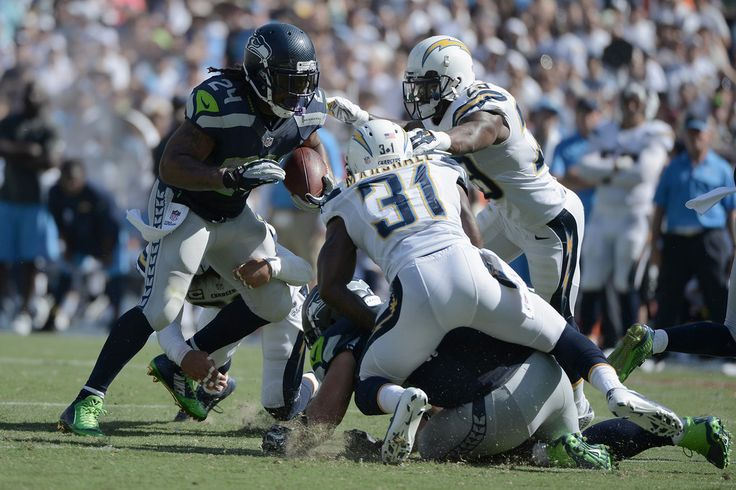 Running back Marshawn Lynch #24 of the Seattle Seahawks runs against cornerback Richard Marshall #31 of the San Diego Chargers at Qualcomm Stadium on September 14, 2014 in San Diego, California.