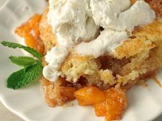 I found this peach cobbler recipe on the internet from the Salt Lick Restaurant in Austin, TX. Everyone loves this recipe so much I have to make a double batch! Feel free to cut back on the sugar. Everyone has and the peach cobbler still comes out perfect. :D  Personally, I always use two bags of frozen peaches instead of canned.