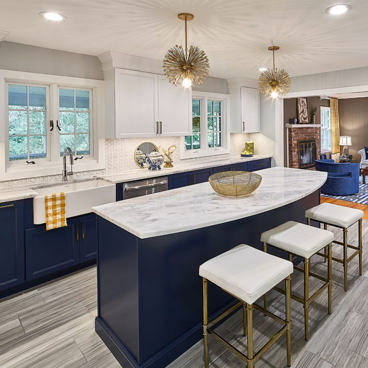 Navy And Blue Kitchen With Brass Accents And Marble