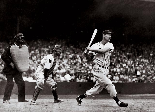 Ted Williams connects with a ball during a 1941 game against Washington. Williams remains one of Boston's all-time most popular players. He retired in 1960 with a .344 batting average.  Photographed by: Courtesy of Brian Interland