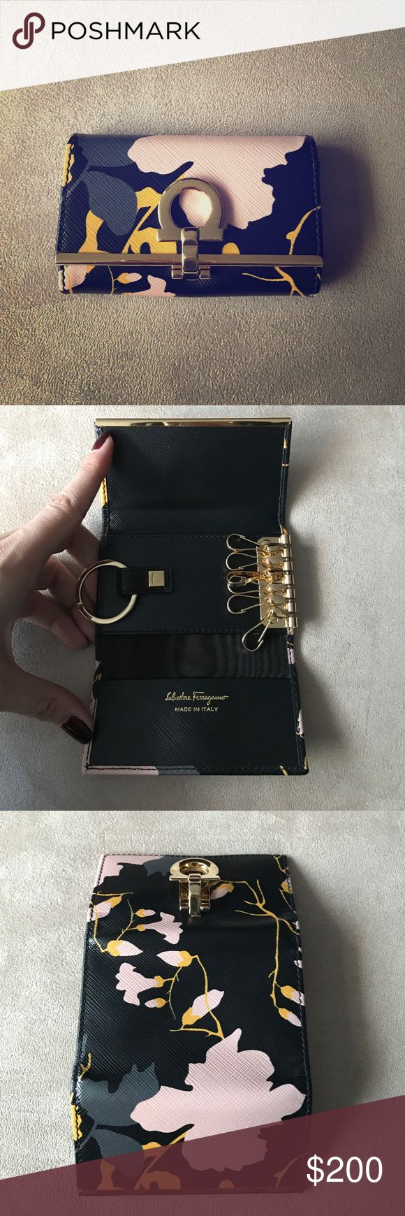 Salvatore Ferragamo Key Wallet Never used brand new Ferragamo key wallet. Has 6 clasps for keys and one large key ring. Pocket for credit card, etc. Salvatore Ferragamo Accessories Key & Card Holders