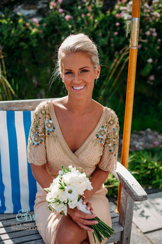 Burgh Island hotel English wedding blog Lucy Wallace Photography Bridesmaid in Virgos lounge dress with embellished capped Sleeves
