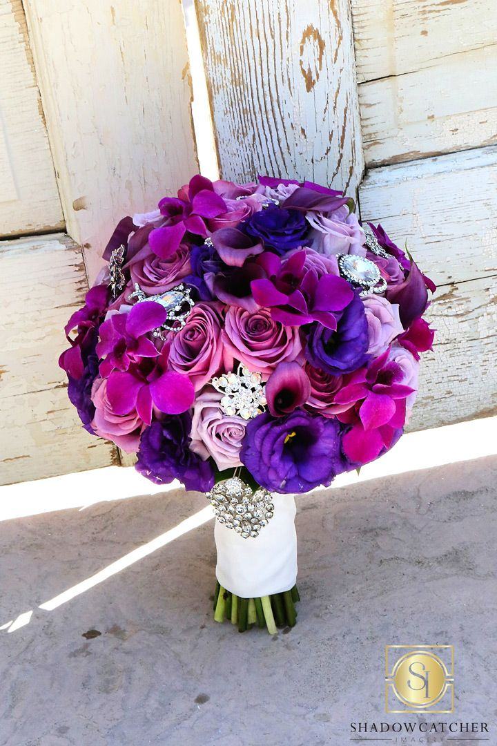 purple wedding bouquet with brooch accents