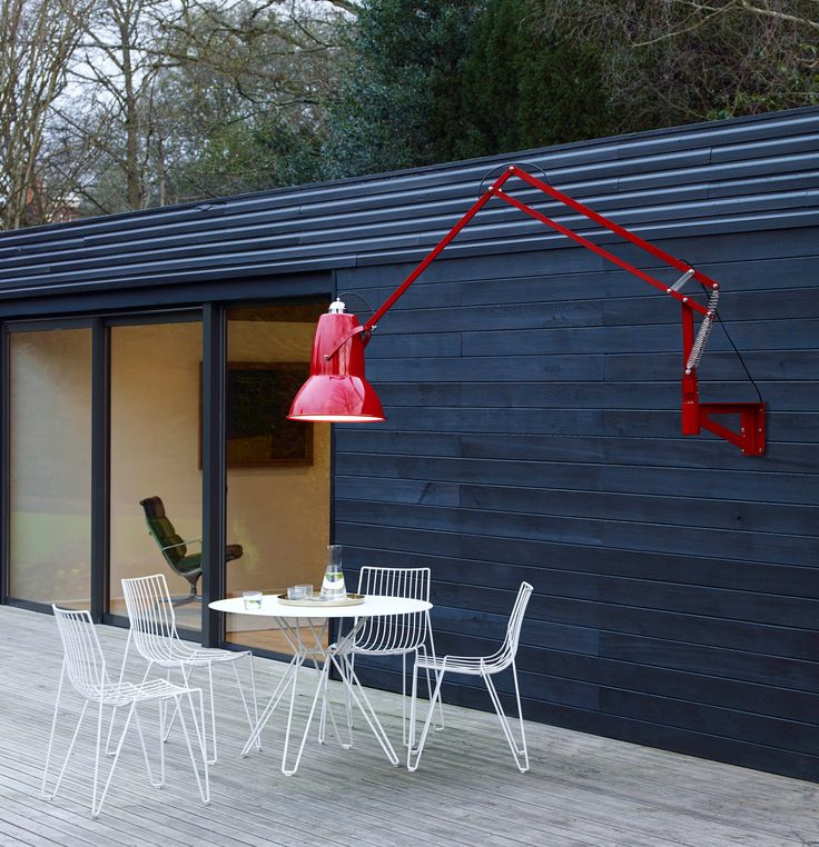 Our Original 1227™ Outdoor Giant wall mounted lamp has all the impact and unrivalled functionality of its floor-standing sibling, but with added flexibility, courtesy of a clever articulated arm. Space saving and discreet when tucked back against a wall, this highly durable lamp takes centre stage when stretched out to illuminate an outdoor space. Pictured in Crimson Red.