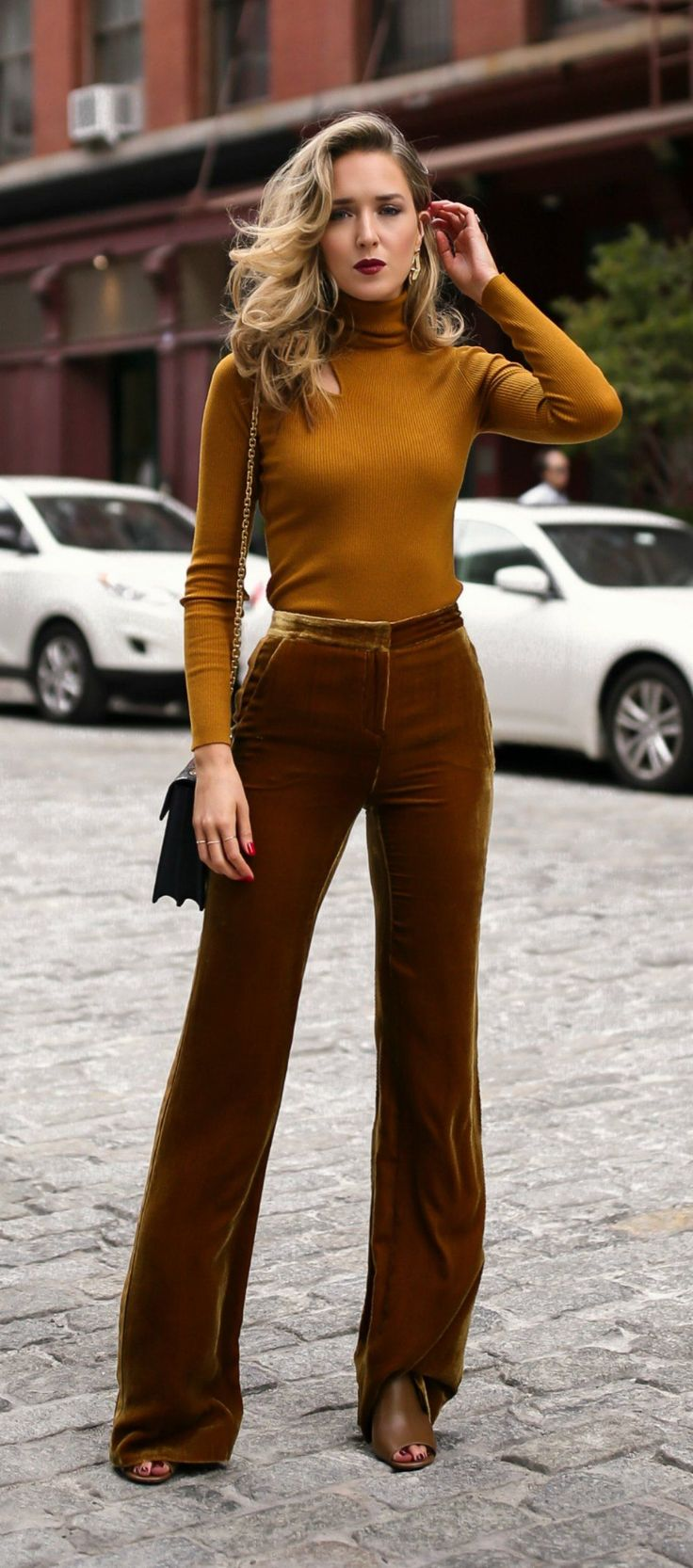 Click for outfit details!  Marigold cut out long sleeve turtleneck, velvet gold tuxedo striped wide leg trousers, multi jewel toned handbag and sculptural gold earrings {ALC, Tory Burch, Veronica Beard, Amber Sceats}