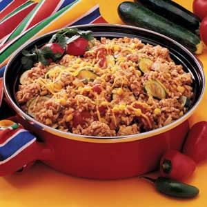 """Fiesta Fry Pan Dinner Recipe -Taco seasoning mix adds fast flavor to this speedy skillet dish from Leota Shaffer. """"It's so easy to make that I fix it frequently,"""" says the Sterling, Virginia cook. """"All I need is salad and dessert, and the meal is ready."""""""