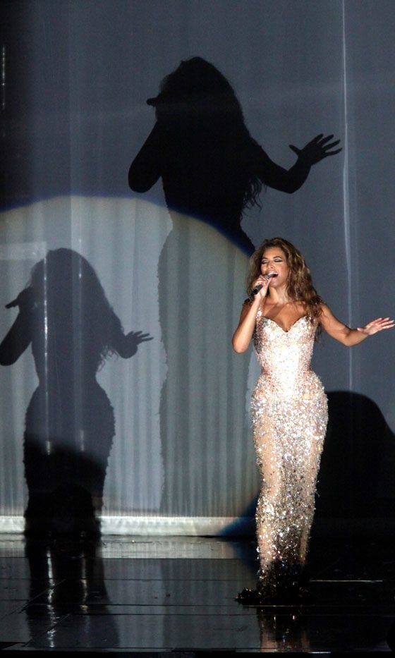 Beyoncé Certainly Has A Stage Presence In This Glittering Gold Maxi Dress For A Concert In Germany, 2009