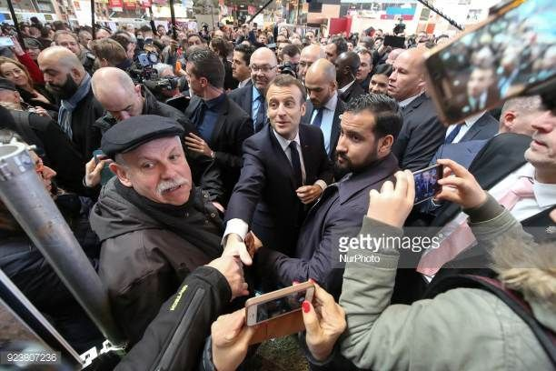 French President Emmanuel Macron visits the 55th International Agriculture Fair at the Porte de Versailles exhibition center in Paris on February 24...
