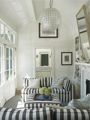 Nautical Stripes without the Navy Blue.  I adore this and wish I could have my morning cup of coffee in this sun room!  Coastal Modern by Tim Clarke via Houzz.com