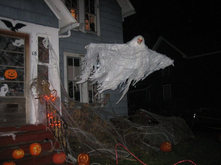 fake cobwebs suspended ghost and pumpkins make for a fun yard display that your trick or treaters are sure to enjoy - Halloween Ideas For Yard