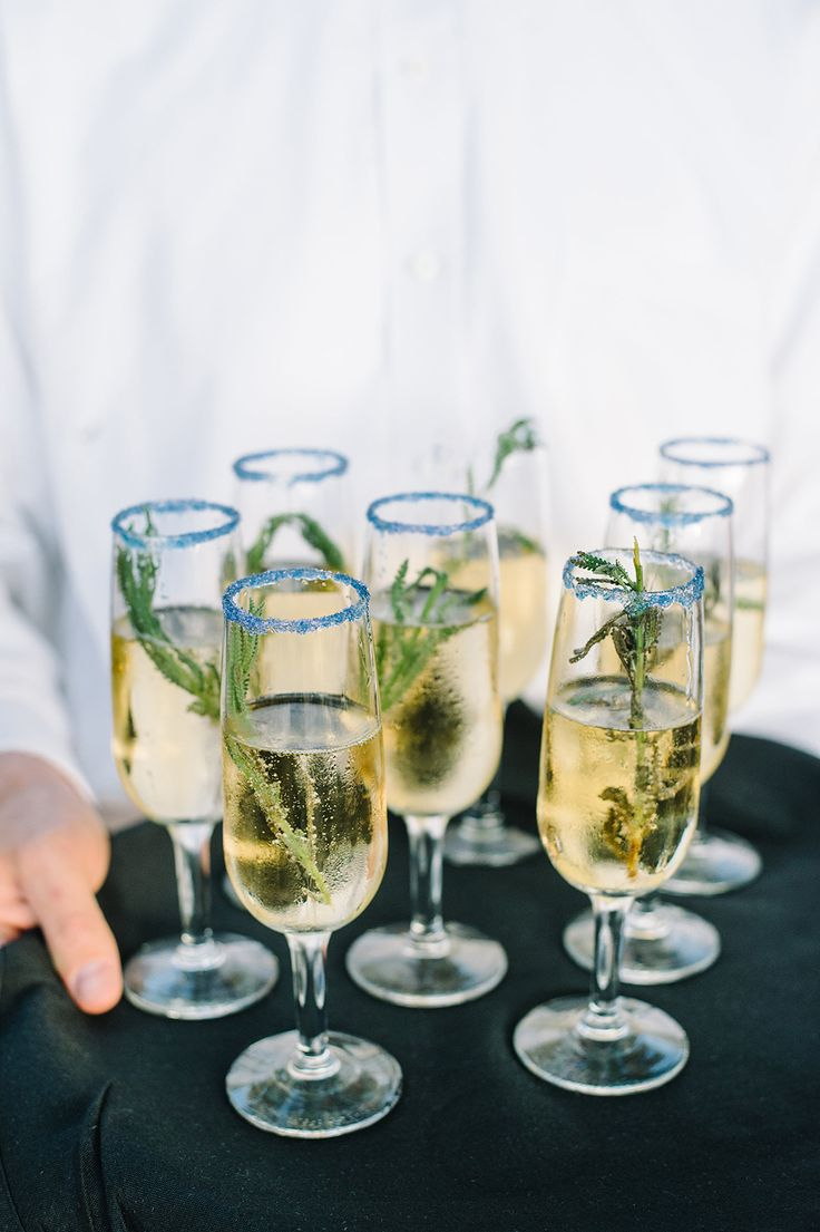 Passed champagne with St. Germaine, lavender sprig and a lavender sugar rim | Summer & John's signature cocktail by PPHG | Fall wedding inspiration | Photo by Aaron and Jillian