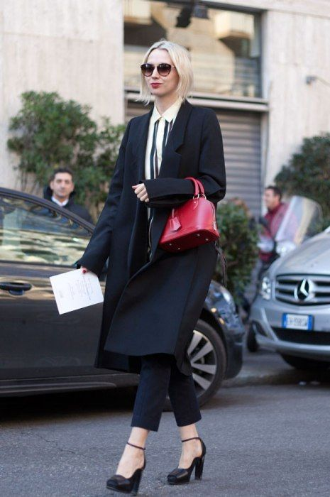 The iconic Alma BB in red Epi leather makes its way on the streets of #MFW (Photography from http://www.vanityfair.com/)