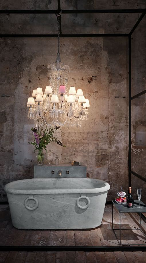 """""""Love love love! Philippe Starck adds a striking contrast to this rustic bathroom with a glitzy and beautifully over the top chandelier"""""""