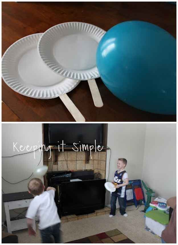 Paper plates, Popsicle sticks, and a balloon are all you need to play Balloon Ping-Pong.