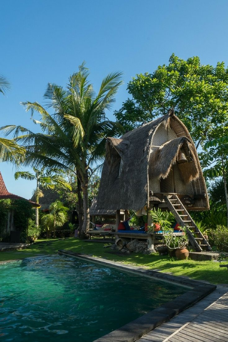 DESA SENI: BALI'S BEST YOGA & WELLNESS RESORT! Winding stone and wooden pathways lead you through lush lawns speckled with organic produce gardens, charming little lounging huts, and restored antique wooden homes collected from various Indonesian Islands.