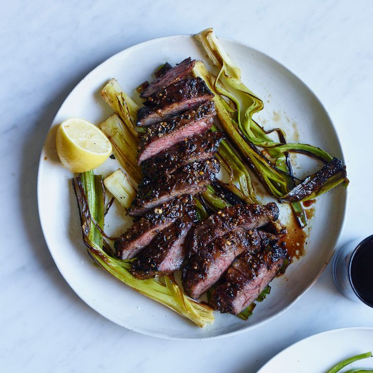 Pepper-Crusted Skirt Steak with Charred Leeks | Star chef Alex Guarnaschelli cooks juicy skirt steak with spices until a crust forms, then she spreads a mix of mustard and vinegar on the meat for a delicious tang.