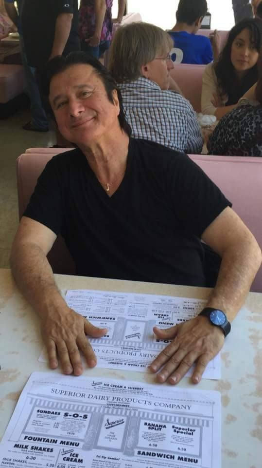 August 23, 2015 Steve Perry (em) Still wearing the necklace (eighth note?) his mother gave him so many years ago!