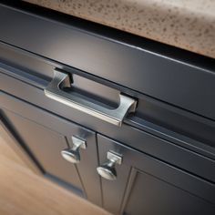 Upgrading your cabinet knobs and pulls is a cheap way to change the look of your kitchen, and it is a great DIY project!