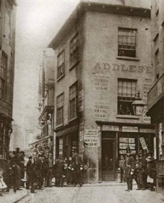 Bridlesmith Gate, Nottingham, c 1861. Junction of Bridlesmith Gate and High Street, showing shops and the bottom of Chandlers Lane which were demolished to make room for Victoria Street.