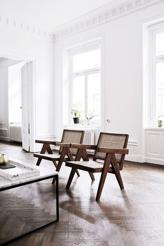 Matching Wood Arm Chairs In Front Of Living Room Table In A Old Building  Apartment. Nice Ideas