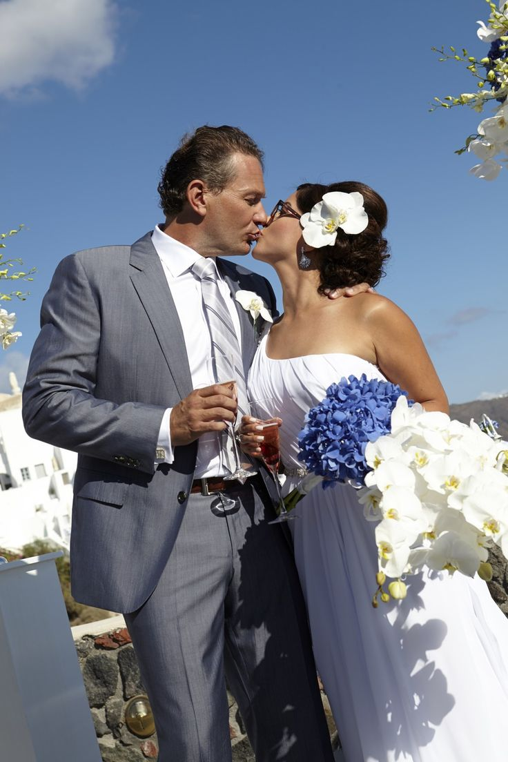 Lovely couple on the terrace of a luxury hotel Santorini Perfect moment lovely kiss