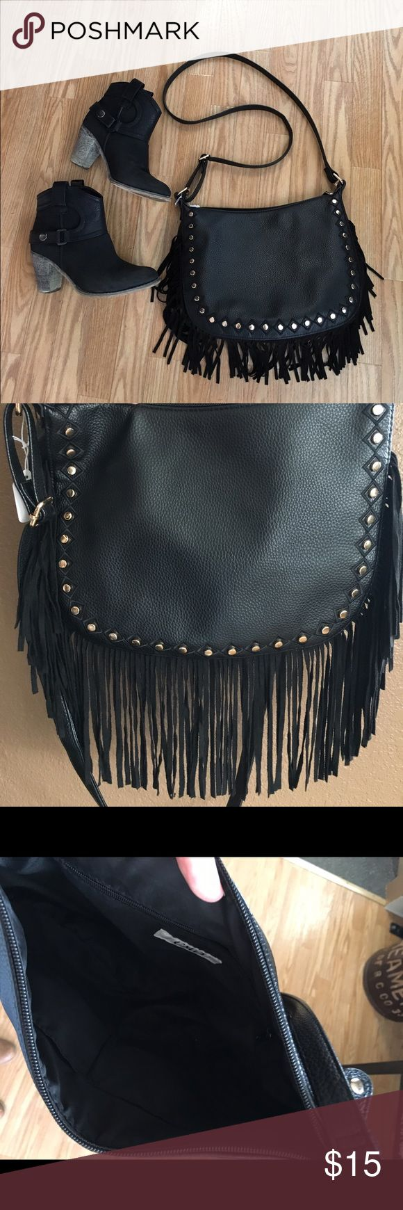 Fringe crossbody purse Hello country girl! Look how cute this fringe purse is. It's great for rodeos, Coachella, county concerts, or just plain wearing it around town. EUC. Medium size with inside zipper. Cato Bags Crossbody Bags