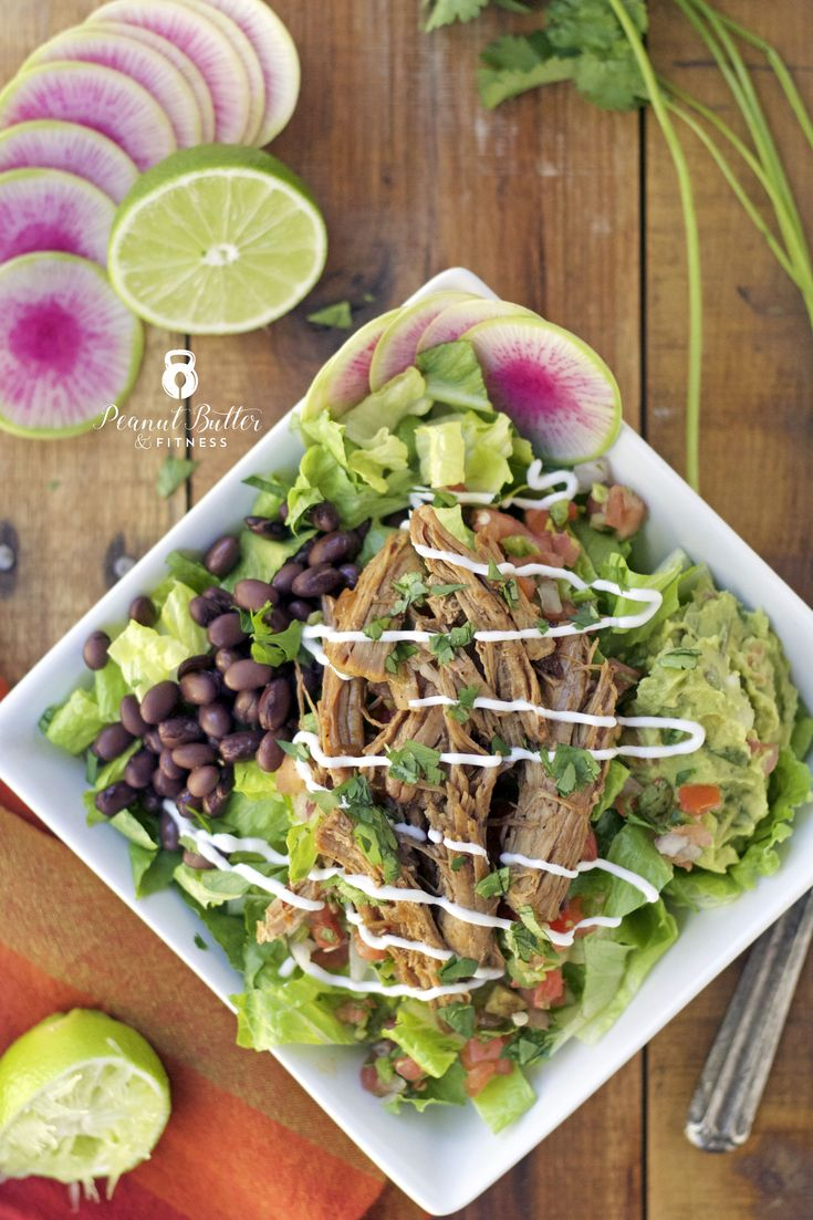 Instant Pot Chipotle Pork Salad Bowl - a lightened up version of a Chipotle Burrito Bowl with the juiciest, fall apart pulled pork you've ever had.  Top it off with some pico de gallo, guacamole and cilantro for the real deal feel.  Yield: 4 servings • Calories per serving: 388 • Fat: 16 g • Protein: 43 g • Carbs: 20 g • Fiber: 5 g • Sugar: 4 g • Sodium: 511 mg • Cholesterol: 103 mg