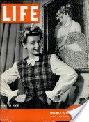 "LIFE Magazine November 16, 1942 - Article, ""Checker King Shows Marines trick of the Game with Mobile USO Unit"", pages 154-157."
