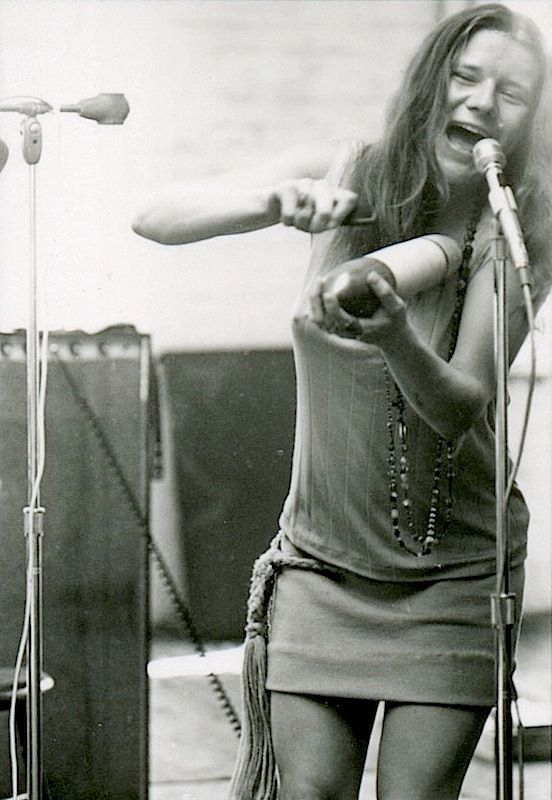 Janis Joplin playing the guiro at rehearsal, 1967.